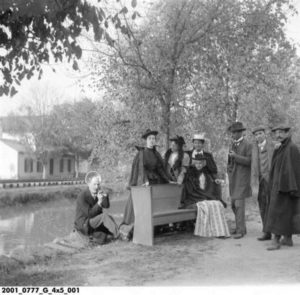 T.C. Steele: third from right holding pipe, J. Ottis Adams: sitting on canal bank