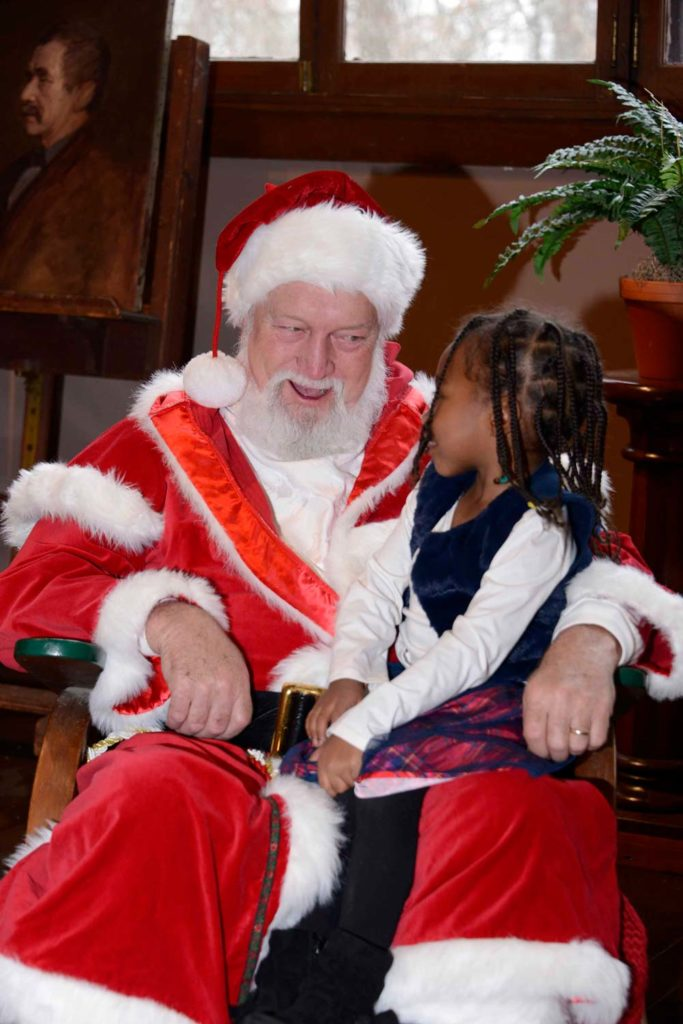 St. Nick talks to a young visitor