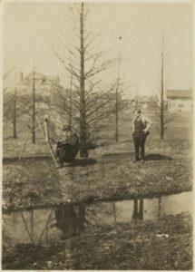 Herman B Wells standing behind Theodore Clement (T.C.) Steele